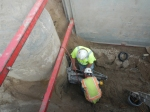 Core drill and install flexible boot into existing manhole, for new sewer line.